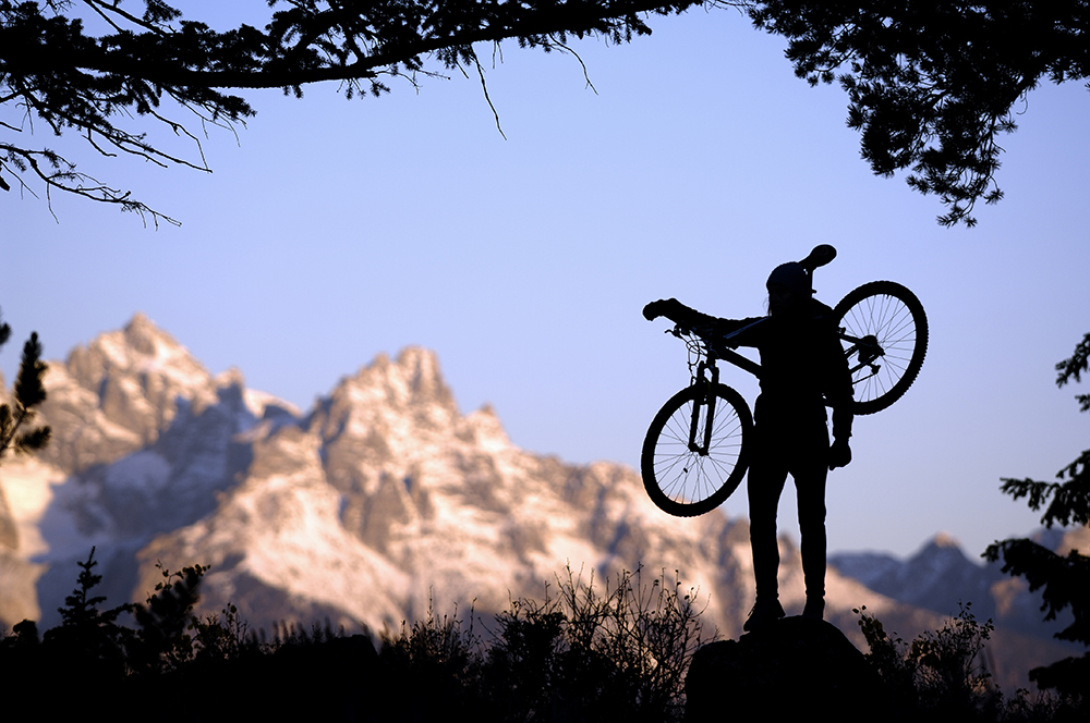 Woman Mountain Biking in Jackson Hole