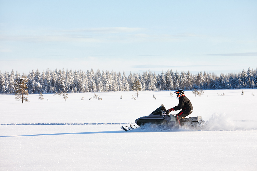 Man Riding Snowmobile Near Anvil Hotel