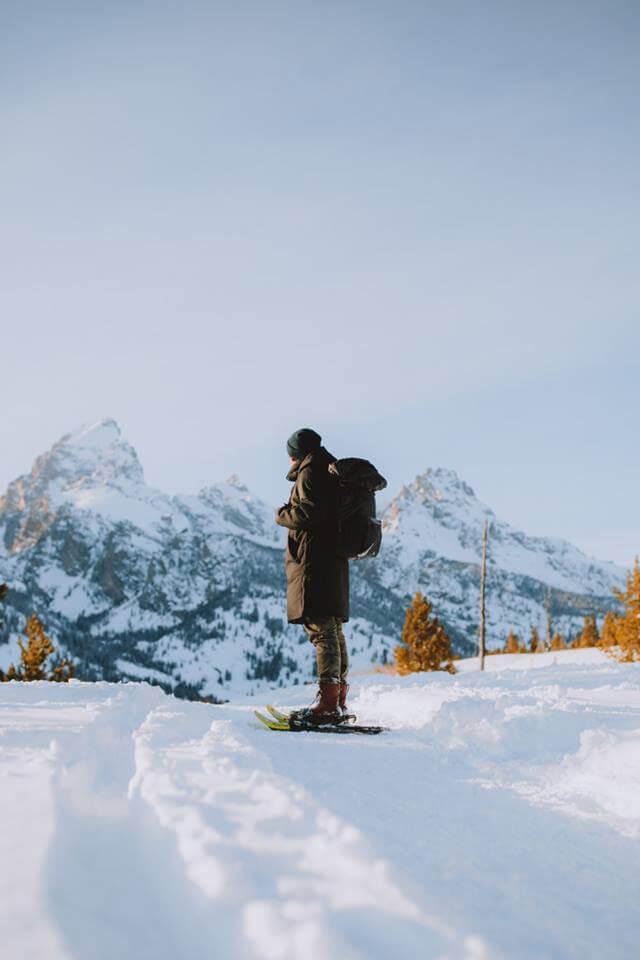 Snowshoeing man under Teton mountains