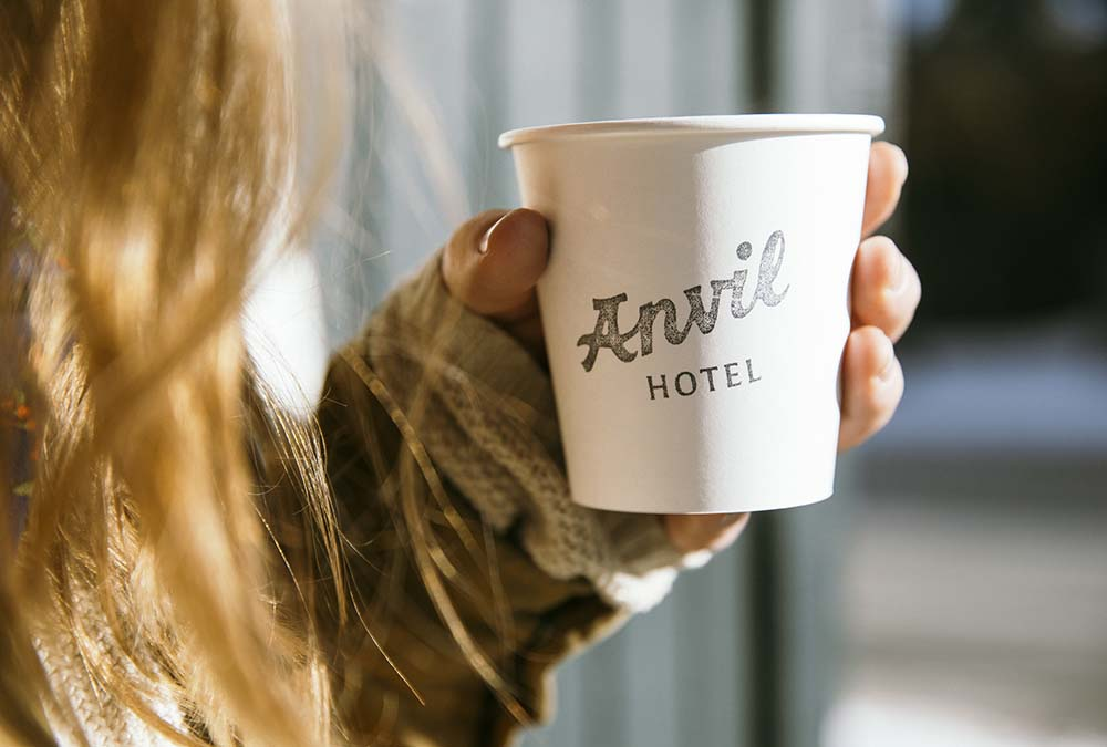 Woman Enjoying Anvil Hotel's Hot Chocolate