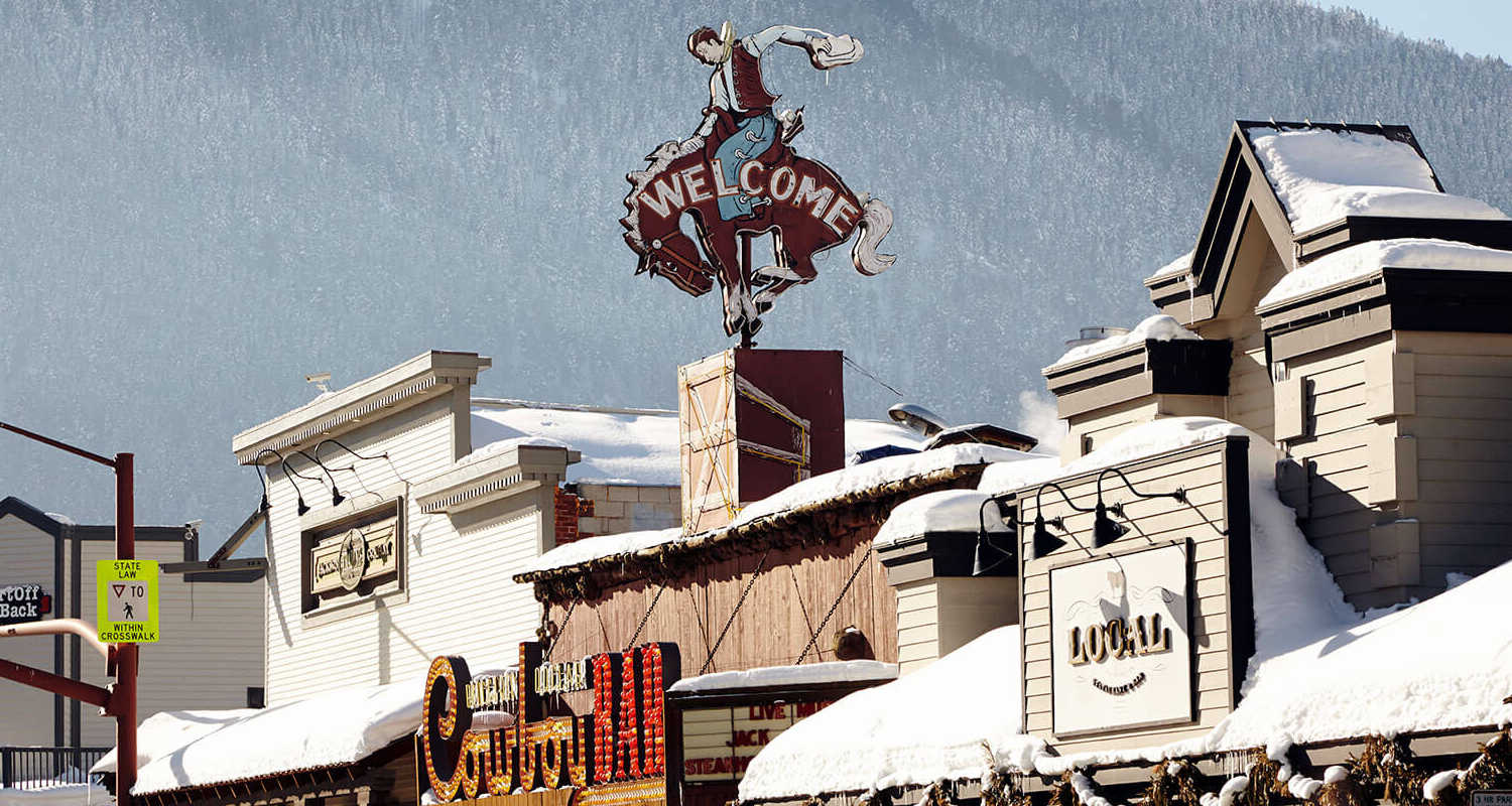 downtown jackson wyoming with snow covered shop roofs