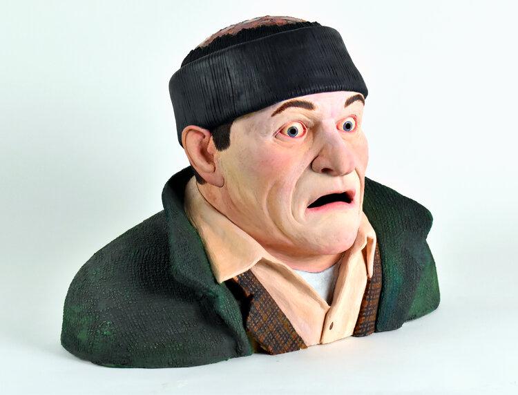 Sculpture of a man shocked